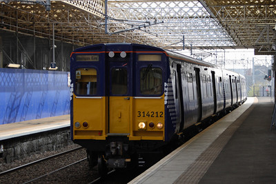 314212 drawing into Platform 2 on a service to Weymss Bay. This is the first Class 314 unit to receive the new Transport Scotland Saltire livery, this being done after overhaul at Glasgow Works.