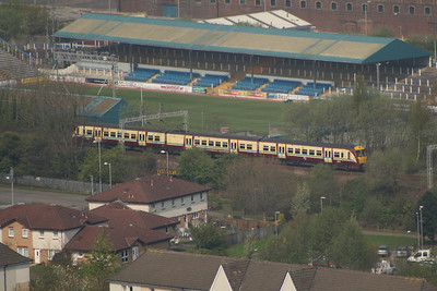A Class 334 unit passing by Cappielow Park in Greenock on a Glasgow Central service