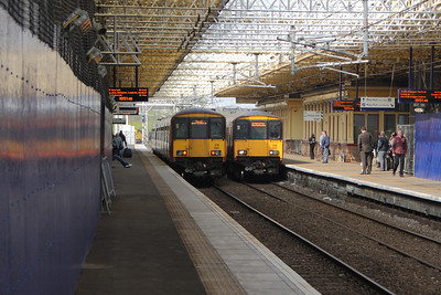 318260 and 318257 at Platform 1 and 2 of Paisley Gilmour Street