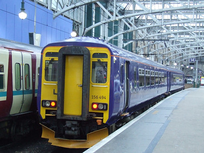 156494 at P14 of Glasgow Central. It is the first Scotrail unit to be painted in the new Saltire blue colour as introduced by the Scottish Government. This will eventually replace SPT and First 'Barbie' colours. It is awaiting it's Scotrail 'Scotland's Railway' branding.
