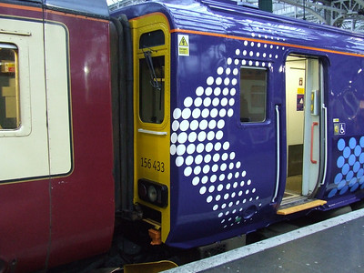 156433 at P8 of Glasgow Central. It is the first Scotrail unit to have in the new Saltire livery as introduced by the Scottish Government. This will eventually replace SPT and First 'Barbie' colours. It is on a multiple unit service with another Class 156 in the SPT colours that it will replace