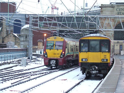 334031 passing 318261 at P12 at Glasgow Central