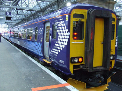 156433 at P8 of Glasgow Central. It is the first Scotrail unit to have in the new Saltire livery as introduced by the Scottish Government. This will eventually replace SPT and First 'Barbie' colours.