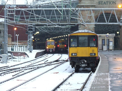 318261 at P12 with 334009 departing P15 on an Ayr service