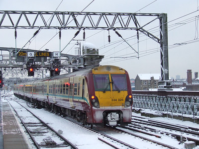 334025 at the rear of a two unit set on a service to Ardrossan Harbour