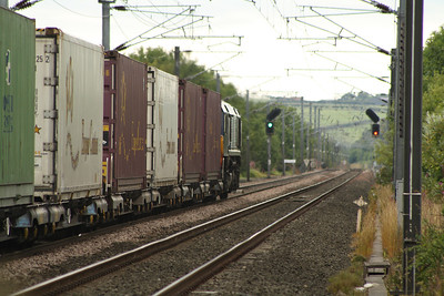66420 passing West Goswick Farm LC on working 4Z75 with the daily intermodal service from Grangemouth to Tyne Dock