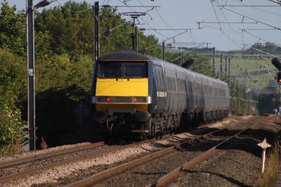 91131 at the rear of a Southbound East Coast service passing over Beal Junction after running through West Goswick Farm LC