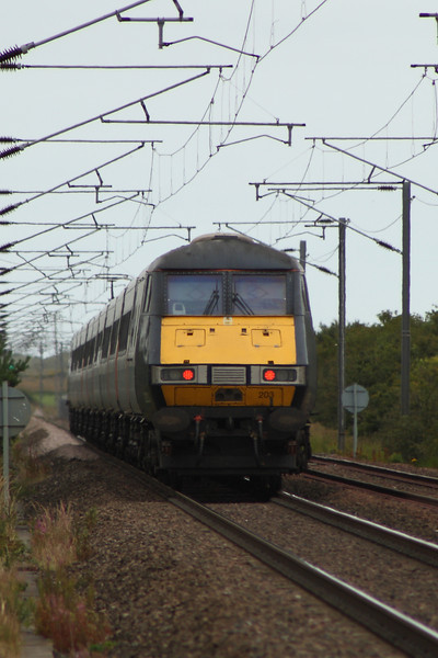 DVT 82203 at the rear of an East Coast service heading North at West Goswick Farm LC. It will soon run though Goswick LC which was also the site of Goswick Station
