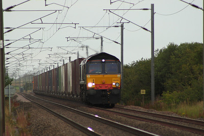 66420 approaching West Goswick Farm LC on working 4Z75 with the daily intermodal service from Grangemouth to Tyne Dock