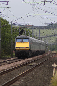 91104 at the rear of an East Coast service heading South as seen from West Goswick Farm LC crossing Beal Junction