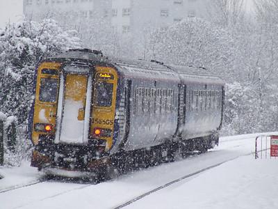 156505 passing through Pollokshaws West in heavy snow on a Carlisle service