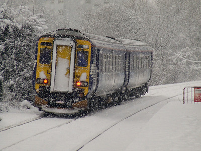 156510 departing Pollokshaws West in heavy snow on a Barrhead service