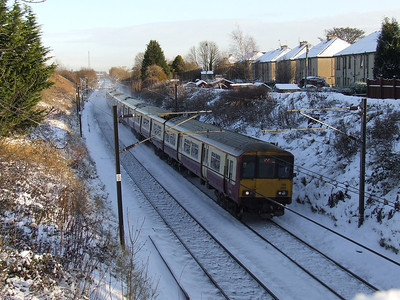 318269 at the head of a Largs service passing through Elderslie