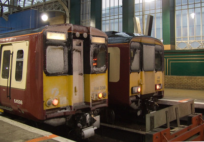 314208 and 318255 at P14 and P15, with a covering of snow on the front
