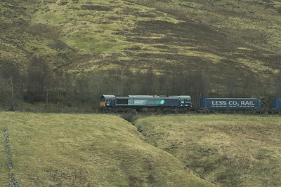 66301 with the empty Tesco containers south of Dalwhinnie on 13 April 2012 on their way back from Inverness to Mossend yard