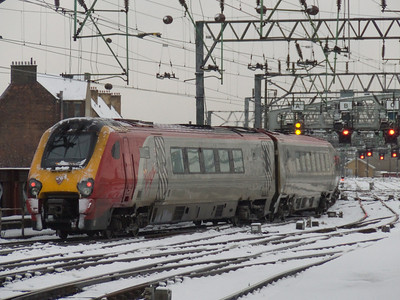 221101 Louis Bleriot departing Glasgow Central on a working to Birmingham New Street. The photo was taken on 8th December 2010. On this day there was an extremely heavy snowfall that resulted in many late or cancelled services, this one running ninety minutes late