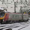 221101 <i>Louis Bleriot</i> departing Glasgow Central on a working to Birmingham New Street. The photo was taken on 8th December 2010. On this day there was an extremely heavy snowfall that resulted in many late or cancelled services, this one running ninety minutes late
