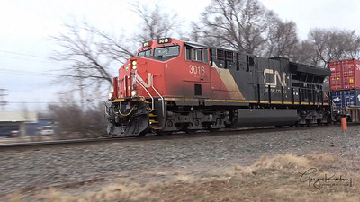 Stealthy northbound CN 3016 on the south side of Waukesha, Wisconsin
