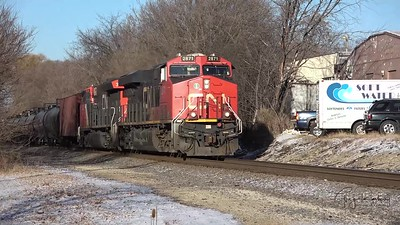 CN running South through Waukesha, Wisconsin at Perkins Ave.