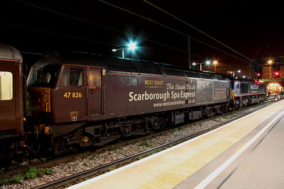 3 April. Carrying ironically Scarborough Spa Express promotional decals, the failed 47826 is seen tucked inside 66412 at Bedford.