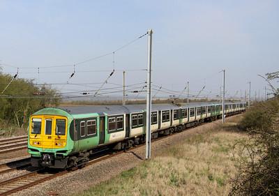 10 April. 319005 + 319215 London pass Millbrook Bridge on th MML with a service for Three Bridges.