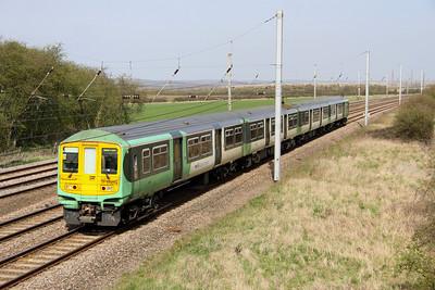 10 April. 319214 heads for Elephant & Castle at Millbrook Bridge .