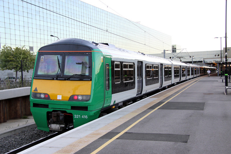 18 August. Unbranded 321416 stands at Milton Keynes with the 0621 to Euston.