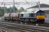 18 August. 66420 has a short payload working the 6C42 0810 Sellafield - Carlisle Yard through Carlisle.
