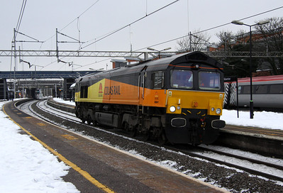 24 December. With the stricken 1G16 in the background, Colas Rail 66841 passes through Wolverton working as the 0Z66 Ripple Lane - Rugby.