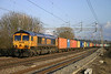 19 February. The sun shines on 66704 Colchester Power Signalbox as she passes Chelmscote with the 4M23 1059 Felixstowe - Hams Hall.