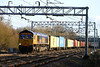 5 February. GBRf's 66710 dodges the shadows at Bradwell with the 4M23 1059 Felixstowe - Hams Hall.