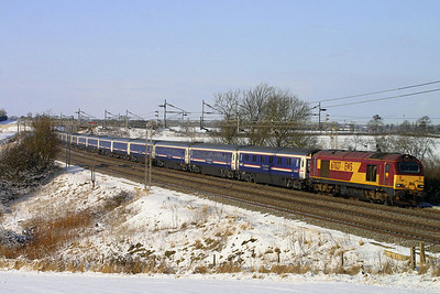 9 January. Running excessively late due to weather conditions north and south of the border, 67027 Rising Star heads past Chelmscote with the previous nights 2038 Inverness - Euston Caledonian sleeper.