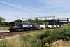 9 July. 66427 bowls along at Gordon's Lodge, just north of Hanslope Junction with the 4M71 1053 Tilbury - Daventry sugarliner.