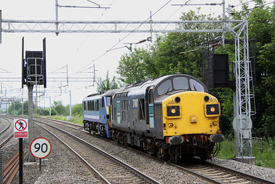 18 June. heading in the opposite direction, 37087 Keighley & Worth Valley Railway 40th Anniversary 1968-2008 tows 90013 through Wolverton working the 0L90 Crewe IEMD - Norwich Crown Point.