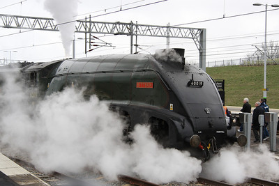 27 March. 60019 BITTERN creates a smokescreen at Milton Keynes on The Palatine.