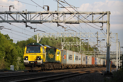 17 May. 70001 PowerHaul is caught before it hits the shadows at Bradwell working the 1413 Felixstowe - Lawley Street.