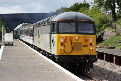 15 May. 56097 is seen at Rushcliffe Halt, East Leake on the Great Central Railway (N) with the 1045 Loughborough - Ruddington.