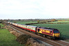6 November. Avoiding the sun, 67024 takes The Wandering Pieman, the 1Z75 0729 Stevenage - Melton Mowbray past Ridgmont.