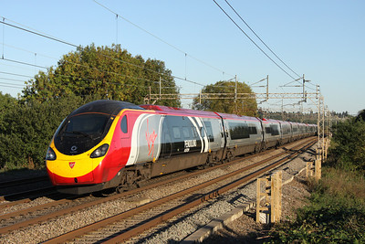 10 October. Alstom liveried 390004 Alstom Pendolino passes Chelmscote heading for Euston.