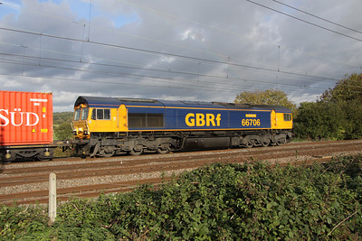 23 October. 66706 Nene Valley is caught broadside passing Chelmscote on the 1252 Hams Hall - Harwich.
