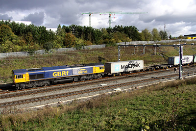 16 October. The cranes in the background are on the site of the new Network Rail HQ offices as 66706 Nene Valley passes Portway on the 4M23 0948 Felixstowe - Hams Hall.