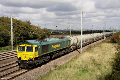 9 September. 66585 The Drax Flyer heads past Millbrook Bridge with the 6L45 0735 Earles - West Thurrock cement.