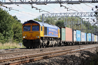 3 September. Named after the designerof the iconic London Underground map, 66721 Harry Beck passes Bradwell working the 4M23 1059 Felixstowe - Hams Hall.