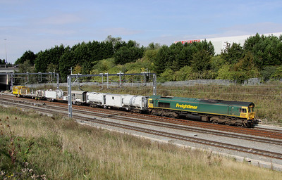 5 September. 66621 is seen approaching Milton Keynes from the north at Portway with the Sussex Rail drain train.
