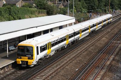 4 September. South Eastern 465002 passes non stop through St. John's heading for London Bridge.