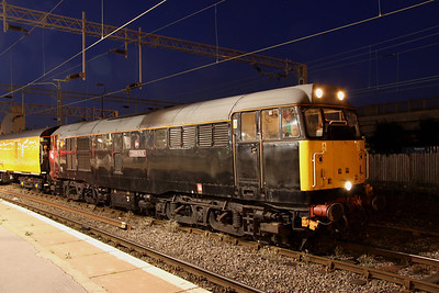 1 September. Plain black 31459 CERBERUS stands at Bletchley with the 3Q70 Bletchley - Derby RTC.