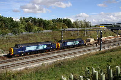 11 September. 37259 + 37218 greet the sun at Portway with the 6Z95 1005 Dungeness - Crewe flask.