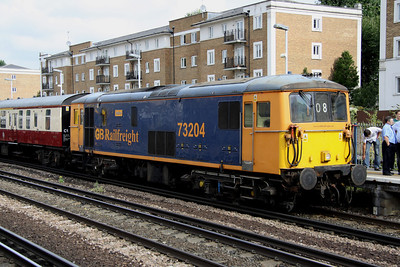 4 September. With 66730 having been detached, 73204 Janice awaits the off from Kensington Olympia.