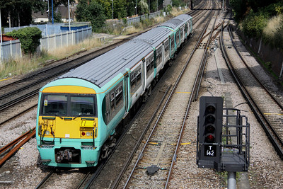 4 September. 456015 456010 are seen at South Croydon heading for London.