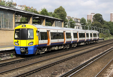 4 September. Three car 378003 leaves Kensington Olympia with the 0935 Clapham Junction - Willesden Junction.